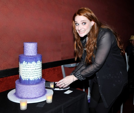 "LOS ANGELES, CA - SEPTEMBER 01: Singer/songwriter Laura Michelle cuts her cake during the album release party for Laura Michelle's ""Novel With No End"" at El Rey Theatre on September 1, 2016 in Los Angeles, California. (Photo by John Sciulli/WireImage)"